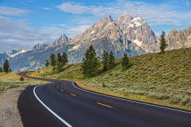 Empty Paved Roadway In Grand Teton Photograph By Chuck Haney