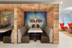 office paneling. a corporate office in austin tx uses reclaimed oak as paneling the employee dining