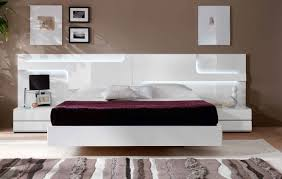 modern furniture design photos. White Floating Bed And Nighstands Used As Modern Bedroom Furniture In Spacious Room With Wide Carpet Design Photos