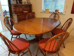 vintage ercol circular extending dining table and six chairs