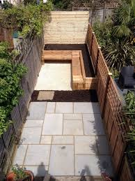 Small Picture Rich fencing panels random sized pavers and a fab seating area