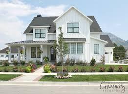 how modern farmhouse exteriors are evolving 2 story house plan