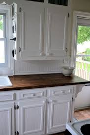 add trim to flat panel kitchen cabinets   ... to remake old cabinets,