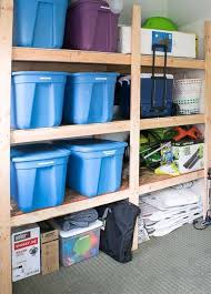 plastic bins and outdoor equipment d on shed shelving