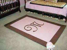 baby girl s pink and brown custom rectangle nursery area rug with a monogrammed initial in the