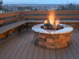 brick and concrete round propane fire pit for comfortable deck use decor