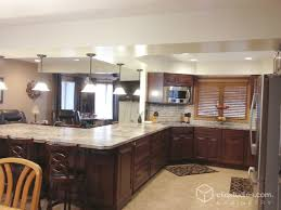 Cherry Kitchen Cabinet Doors This Traditional G Shaped Kitchen Features The Carlton Raised
