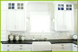 bianco carrara marble subway tile backsplash white kitchen cabinets with elegant black counter farmhouse sink full