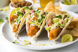baja fried fish tacos with spicy cabbage slaw