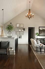 chic cottage open living space with cathedral ceiling wall panels groove walls oly studio flower drop chandelier smoke gray recycled glass vase