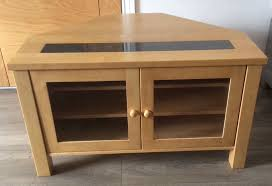 corner tv unit solid wood with granite insert and glass doors