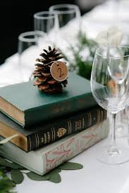 Pine Cone Wedding Table Decorations Vintage Book Centerpieces With Pine Cone Table Numbers