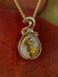 gold quartz diamond pendant in yellow gold