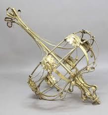 a large brass art nouveau style chandelier
