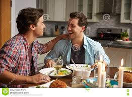 Kitchen Dinner Male Gay Couple Having A Romantic Dinner In Their Kitchen Stock