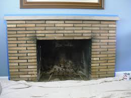so after a couple coats of primer and a couple coats of paint i had this a new white fireplace that was only about quarter of the way done