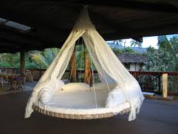 View in gallery Awesome round hanging bed design for a vacation-like feel