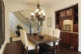 light and bright tuscan style dining room and entryway foyer