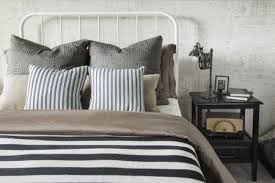 how to make a beautiful bed. Beautiful Make Striped And Patterned Pillows Blanket On Bed On How To Make A Beautiful Bed