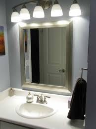 above mirror bathroom lighting. Above Mirror Lights Inspiring Lowes Lighting Bathroom Design Long With Urevoocom Light Fixtures O