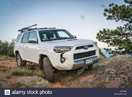 Toyota 4Runner SUV (2016 Trail edition) on a rocky trail in Stock ...