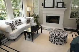 white living room furniture small. Small Living Room Mainly In White With A Black And Patterned Round Ottoman Sofa Furniture