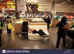 A man sleeps on a couch in the Swedish furniture store IKEA in