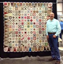 Dear Jane quilts   I Finally Have Time & Jim with the quilt made by Goldie Morrow. Adamdwight.com
