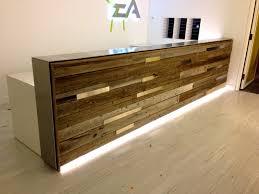 elegant wooden standing reception desk with beige wall color and laminate floor for excellent office decor