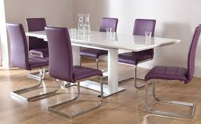 clean white freestanding dining table paired with contemporary purple chairs set on laminate floor idea