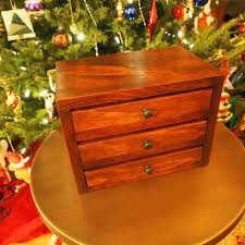 a diy jewelry box in front of a tree
