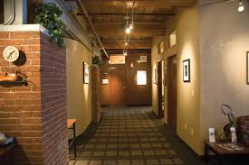 hallway track lighting. lowvoltage track lighting illuminates the hallway that looks more like a highend boutique hotel than medical office e