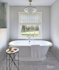 bathroom glass bathroom chandeliers in contemporary white themed room also round desk with candle ornaments