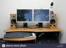 speakers desk. modern pc on desk with speakers and dual flatscreen monitors