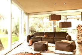 brown couch country living room with cowhide rug decor bedroom