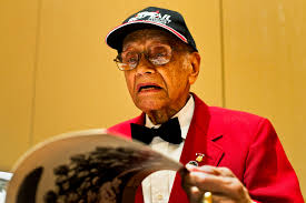 u s department of defense photo essay elmer jones autographs tuskegee airmen books at a book signing event during the tuskegee airmen s 40th