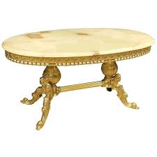 golden chiseled brass coffee table with onyx top for