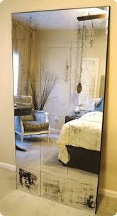 antiqued standing mirror