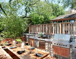 outdoor kitchen with built in grill and sink