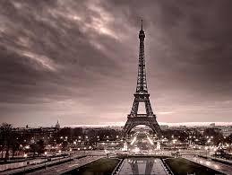Eiffel tower illuminated seen in the night with seine river in paris. Eiffel Tower Paris France Afar