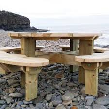 round pine picnic table 6 8 or 12 seater side view