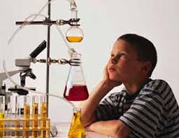 science fair projects science tracer bullet science reference  photo young boy gazing up at beakers in a lab