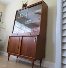 reserved vintage mid century modern walnut china cabinet hutch sliding glass doors