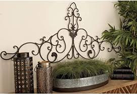 Large metal wall art measures 29l x 4w x 29h and weighs 9.2 lbs. Amazon Com 59 Inch Arched Scrollwork Metal Wall Decor By Brown Iron Home Kitchen