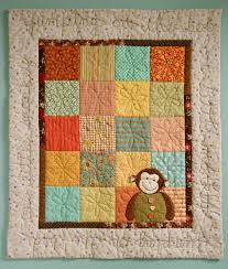 PatchworkPottery: One Little Monkey & As you can see the border changed for the better with my husband's valued  opinion! The rusty red border really was too dark. Adamdwight.com