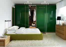 bedroom design for couples. Simple Modern Bedroom Designs For Couples With Green Bed And White Linen Also Dark Wardrobe Sliding Door Looks Luxury Fur Rug Design