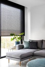 Simple modern living room in greys and blues // Roller blind in Baltic  translucent fabric and pumice colour.
