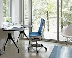herman miller office design. a home office with treetop view the interior features herman miller envelop desk embody chair and eames molded plastic armchair design e
