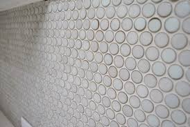 anyone who has tiled knows that grout often leaves a bit of a hazy on your tile we saw it on both the subway tile and the marble floor tile in