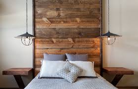 floor to ceiling headboard with wooden planks in the rustic bedroom design